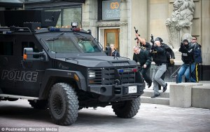 Guns raised- Emergency responders escort VIPs out of building on Sparks Street near the Post Office - http://www.dailymail.co.uk