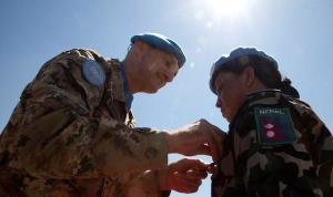 Major-General Luciano Portolano, UNIFIL Force Commander and Head of Mission awards United Nations peace medal to Nepalese peacekeeper
