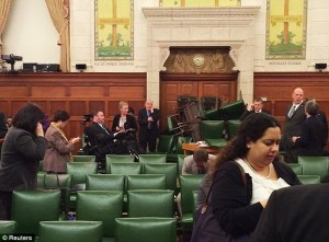 People inside the Conservative Party caucus room blocked the door with a stack of chairs - http://www.dailymail.co.uk