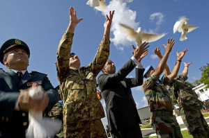 Releasing doves at the end of the ceremony marking International Day of Peace